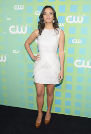 Jessica Lucas was spotted at the CW Network's New York 2012 Upfront wearing a white mini cocktail dress with peplum detailing.