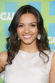 Jessica Lucas showed off her style by accessorizing with pretty dangle earrings with gold detail.