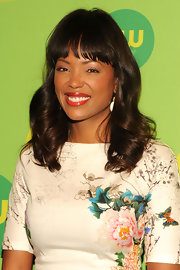 Aisha Tyler's chocolate tresses looked soft, smooth and full of life at CW's Upfront.
