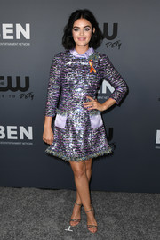 Lucy Hale continued the shine with a pair of strappy silver heels by Schutz.