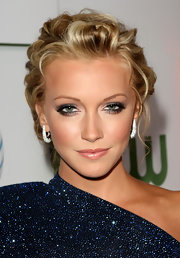 Katie Cassidy hit the 'Melrose Place' party with gunmetal metallic shadow glazed on her upper lids. Her smoky look was completed with a bronzed cheek.