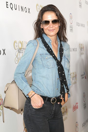 Katie Holmes teamed her jeans with a black leather belt.