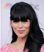 TV host Crash Barrera showed off her blunt cut bangs and straight long locks while hitting this L.A. event.