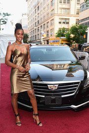 Kelly Rowland made a super-sexy appearance at the Cadillac House grand opening in a slinky gold slip dress.