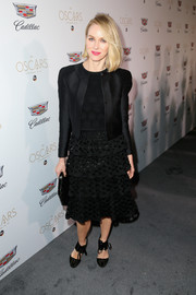 Naomi Watts finished off her all-black attire with a pair of lace-up satin pumps.