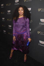 Angela Bassett was cool and chic in a purple Missoni sweater that she wore off one shoulder at the Cadillac Oscar week celebration.