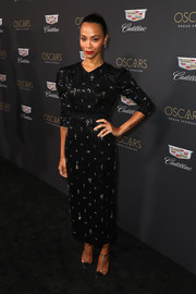 Zoe Saldana cut an elegant figure in a beaded black dress by Erdem at the Cadillac Oscar Week celebration.