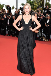 Lily Donaldson oozed sexy elegance in a cleavage-baring black gown while attending the Cannes opening gala.