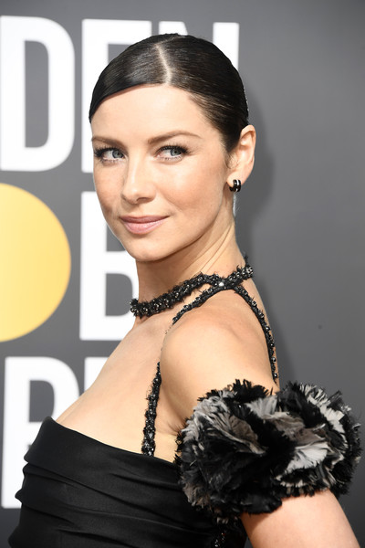 Caitriona Balfe Classic Bun [hair,hairstyle,shoulder,beauty,eyebrow,fashion model,chin,bun,black hair,chignon,arrivals,caitriona balfe,beverly hills,california,the beverly hilton hotel,golden globe awards,the 75th annual golden globe awards]
