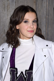 Millie Bobby Brown attended the Calvin Klein fashion show wearing her hair in shoulder-length curls.
