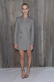 Margot Robbie looked sharp in a gray blazer dress by Calvin Klein during the brand's Fall 2018 show.