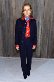 Isabelle Huppert kept it relaxed and cool in a denim suit by Calvin Klein during the brand's Fall 2018 show.