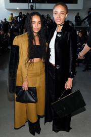 Zoe Kravitz arrived for the Calvin Klein fashion show wearing a funky fur-sleeve wool coat from the brand.