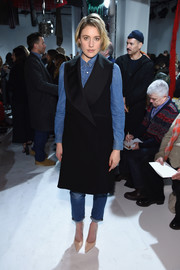 Greta Gerwig looked cool at the Calvin Klein fashion show wearing a sleeveless black tux dress by Jonathan Cohen over jeans and a denim shirt.