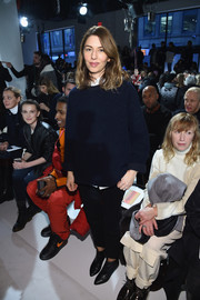 Sofia Coppola attended the Calvin Klein fashion show wearing a loose navy sweater and black jeans.