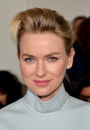 Naomi Watts pulled her hair back in to a messy-chic bun with teased bangs for the Calvin Klein fashion show.
