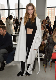 Chiara Ferragni added some warmth to her crop-top with a bulky white wool coat when she attended the Calvin Klein fashion show.