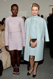 Naomi Watts attended the Calvin Klein fashion show wearing a retro-chic pastel blue coat and dress combo from the brand.