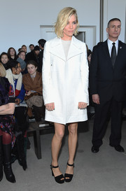 Sienna Miller looked impeccable at the Calvin Klein fashion show wearing this textured white coat from the label.