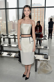 Tao Okamoto's white pencil skirt and strapless crop-top were a very sophisticated pairing.