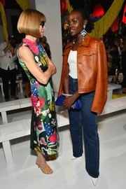 Lupita Nyong'o hit the Calvin Klein fashion show wearing a camel-colored leather jacket and a pair of bootcut jeans.