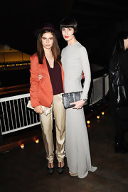 Model Erin O'Connor, at the Calvin Klein Collection Dinner, accessorized her outfit with a dark silver gray leather clutch.