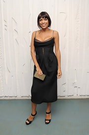 Rosario Dawson accessorized her sexy black dress with simple strappy black sandals.