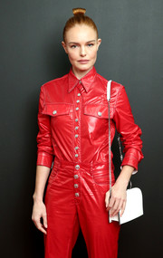 Kate Bosworth teamed a white chain-strap bag with red separates for the Calvin Klein Spring 2019 show.
