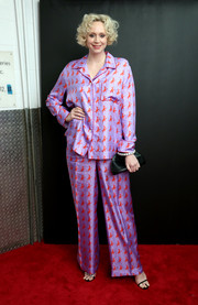 Gwendoline Christie went pajama-chic in a pair of printed lilac satin pants at the Calvin Klein Spring 2019 show.