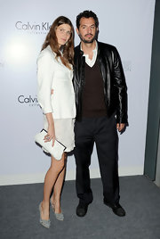 Michelle carried a white leather clutch for her minimalist look at the Calvin Klein celebration in LA.