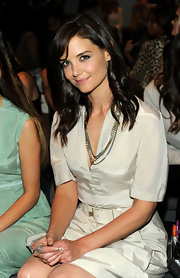 Katie showed off her medium length curls while sitting front row at Calvin Klein.