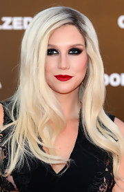 Kesha chose retro-red lips to top off her glamorous beauty look.