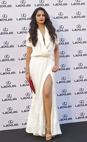 Camila Alves lengthened her legs with a pair of tan patent platform sandals.