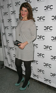 Nia Vardalos added a pop of color to her monochromatic ensemble with blue suede pumps with green platforms.