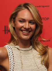 Candice Swanepoel looked super pretty with her wavy layers during the launch of her new Bottletop collection.