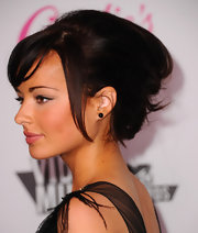 Ashley Rickards arrived at the Candie's 2011 MTV Video Music Awards after party with a soft, casually pinned-up 'do with a few face-framing pieces and side-swept bangs.