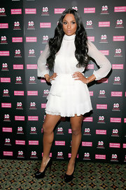 Ciara looked angelic in a white chiffon cocktail dress with long sleeves for the Candie's Foundation benefit gala.