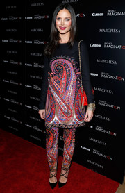 Georgina Chapman attended the screening of 'A Dream of Flying' in NYC wearing a colorful paisley blouse and matching pants.