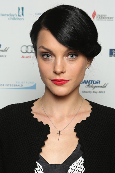 Jessica Stam kept accessories to a minimum, wearing only a cross pendant necklace and a pair of small hoop earrings.