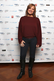 Caroline Manzo was dressed for comfort in a loose blouse, jeans, and knee-high boots at the Cantor Fitzgerald Charity Day.