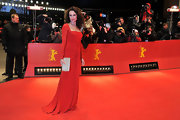Andie MacDowell was red hot in this gorgeous gown at the Berlin Film Festival.