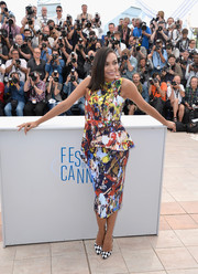 Rosario Dawson finished off her busy-looking ensemble with a pair of black-and-white harlequin pumps by Bionda Castana.