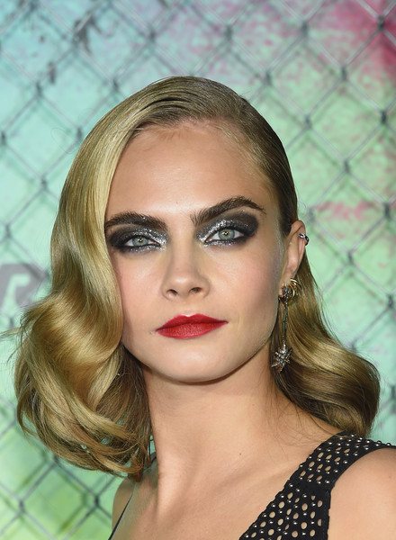 Cara Delevingne Medium Curls [eyebrow,face,beauty,lip,hairstyle,fashion model,chin,blond,forehead,cheek,world premiere - inside arrivals,cara delevingne,new york city,the beacon theatre,suicide squad,world premiere]