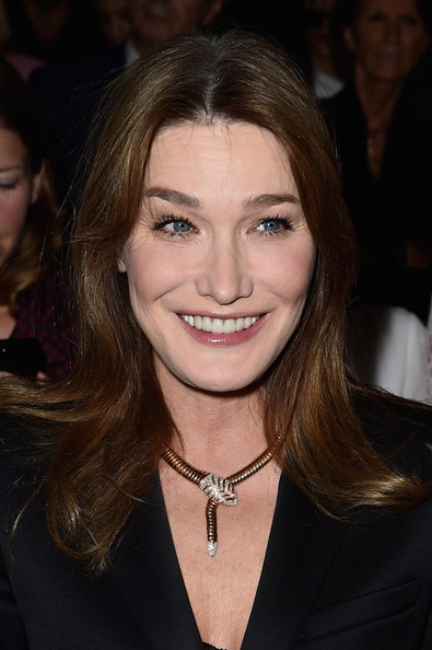 Carla Bruni-Sarkozy Long Center Part [hair,face,hairstyle,eyebrow,beauty,chin,brown hair,blond,long hair,layered hair,christian dior,carla bruni-sarkozy,front row,part,paris,france,paris fashion week womenswear spring]