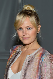 Malin Akerman styled her hair into a top knot for the Carlisle fashion show.