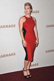 Kate Winslet topped off her figure-flattering Stella McCartney frock with black strappy sandals.
