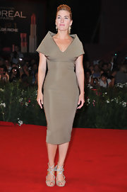 Kate Winslet showed off her figure in a taupe dress with a structured neckline. She finished off the look with jeweled heels and a teased ponytail.
