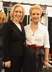 Carolina Herrera sported her trademark crisp white shirt during her Fall 2012 fashion show.