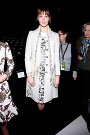 Elettra Wiedemann exuded a vintage vibe in a white tweed coat layered over a print dress at the Carolina Herrera fashion show.