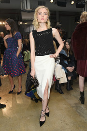 Skyler Samuels paired her cute top with a high-slit white pencil skirt.